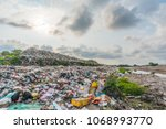 the large heap garbage dump... | Shutterstock . vector #1068993770