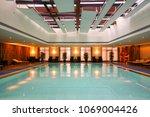 luxury swimming pool part of... | Shutterstock . vector #1069004426