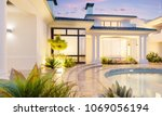 backyard with a pool in an... | Shutterstock . vector #1069056194