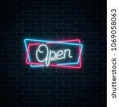neon open hand drawn sign in... | Shutterstock . vector #1069058063