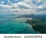 aerial view on turquoise lagoon.... | Shutterstock . vector #1069058996