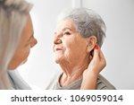 otolaryngologist putting... | Shutterstock . vector #1069059014