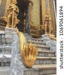 Small photo of Stairs and statues blaring golden horns in Bangkok Royal Palace - Thailand