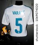 Small photo of MADRID - APRIL 14, 2018: Raphaele Varane 5 France, Actual shirt of season 2017-2018, Museum of Real Madrid soccer team, Santiago Bernabeu Stadium