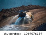 heavy truck pours the road with ... | Shutterstock . vector #1069076159