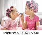 happy childhood. two sisters... | Shutterstock . vector #1069077530