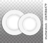 two white round plates or... | Shutterstock .eps vector #1069086479