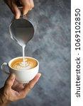 barista making cafe latte art...   Shutterstock . vector #1069102850
