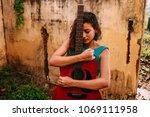 young beautiful woman hugging... | Shutterstock . vector #1069111958