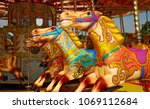 three colourful horses on a... | Shutterstock . vector #1069112684