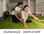 physical therapist assisting... | Shutterstock . vector #1069117649