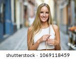 smiling young woman in urban... | Shutterstock . vector #1069118459