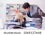 angry irate boss yelling and... | Shutterstock . vector #1069127648