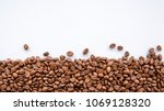coffee beans on grey background ... | Shutterstock . vector #1069128320