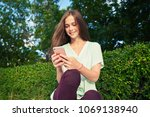 young cute woman using phone... | Shutterstock . vector #1069138940