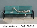 Skeleton Reclining On Blue...