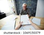 happy mature teacher giving... | Shutterstock . vector #1069150379
