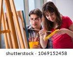 artist coaching student in... | Shutterstock . vector #1069152458