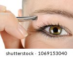 woman in cosmetics and facial...   Shutterstock . vector #1069153040