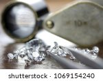 brilliant cut diamond held by... | Shutterstock . vector #1069154240