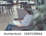 young girl reading a book in... | Shutterstock . vector #1069158866