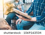 close up of a man holding hymn... | Shutterstock . vector #1069163534