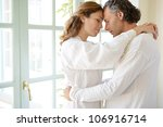 mature couple hugging in a... | Shutterstock . vector #106916714