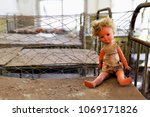a toy doll baby sitting on a... | Shutterstock . vector #1069171826
