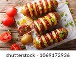 simple snack of potato skewers... | Shutterstock . vector #1069172936