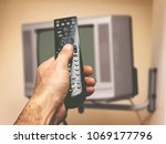 remote control in man's hand  | Shutterstock . vector #1069177796