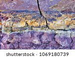 cracks and colorful layers in... | Shutterstock . vector #1069180739