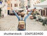 happy tourist girl walking in... | Shutterstock . vector #1069183400