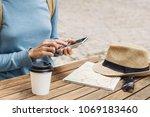 young traveller woman sitting... | Shutterstock . vector #1069183460