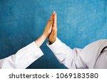 two doctors doing high five... | Shutterstock . vector #1069183580