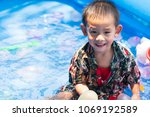 asian boy who playing with the... | Shutterstock . vector #1069192589