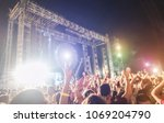 blurred people dancing and... | Shutterstock . vector #1069204790