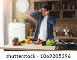 disappointed man cooking... | Shutterstock . vector #1069205396