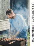 a man with a beard near the... | Shutterstock . vector #1069207553