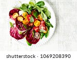 colorful summer salad with... | Shutterstock . vector #1069208390