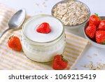 white yogurt in glass bowl with ... | Shutterstock . vector #1069215419