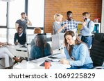 young pretty worker talking on... | Shutterstock . vector #1069225829