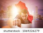 flying super hero over the city  | Shutterstock . vector #1069226279