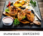 roast chicken wings with baked... | Shutterstock . vector #1069226543