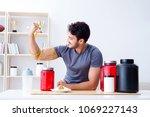 athlete tasting new protein... | Shutterstock . vector #1069227143