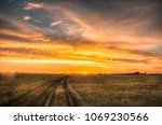 road in the steppe under... | Shutterstock . vector #1069230566