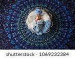 sleeping newborn baby   Shutterstock . vector #1069232384