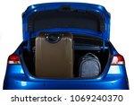 luggage in blue modern sedan... | Shutterstock . vector #1069240370