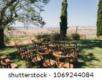 wooden chairs stand on green... | Shutterstock . vector #1069244084