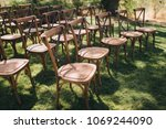 wooden chairs stand on green... | Shutterstock . vector #1069244090