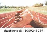 multiracial runners in a modern ... | Shutterstock . vector #1069245269